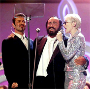 GEORGE MICHAEL, ANNIE LENNOX AND PAVAROTTI Luciano Pavarotti and his Friends, an organization created to help and support carity organizations around the world, a big concert every summer in Modena Italy with Brian May from Queen, Steve Wonder, George Michael, Zucchero, Laura Pausini, Lady Diana as special guest, The Spice girls, Andrea Bocelli, Bono from U2, Liza Minelli, and an incredible list of international guest coming to help childrens as Luciano's Friends